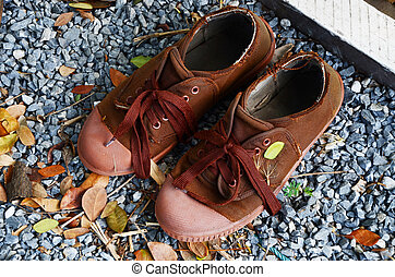 shoes boy scout brown on ground gravel - Classic old brown...