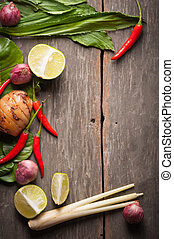 Ingredients set for Thai spicy soup (Tom-yum) include lemon,...