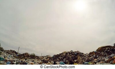 Sun In Grey Sky Over Garbage Dump In Ukraine - Low angle...