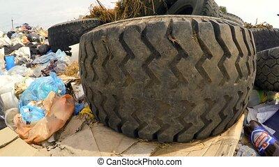 Car Wheels At Garbage Dump