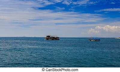 large tourist boats drift against boundless sea - two large...