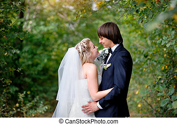 Bride and groom in park summer outdoor