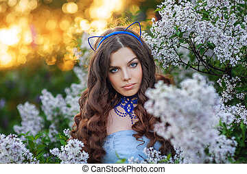beautiful young woman in the spring looking directly at the...