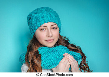 beautiful young woman in a knitted hat