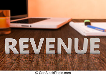 Revenue - letters on wooden desk with laptop computer and a...