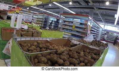 Man chooses potatoes bought in the store the first person on...