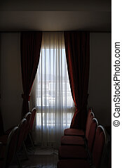 Red curtains in a hotel room.