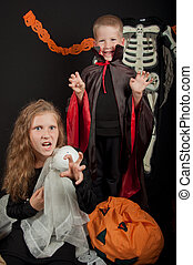 The boy and girl wearing halloween costumes - The boy and...