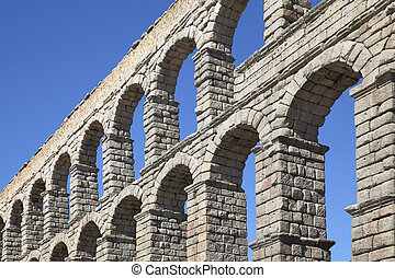 Aqueduct - Perspective of ancient roman aqueduct in Segovia,...
