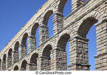 Aqueduct - Perspective of ancient roman aqueduct in Segovia,...