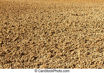 acre - An evenly plowed brown field as background