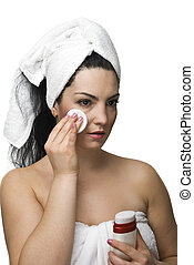 Woman removing make up - Beautiful woman in towel cleansing...