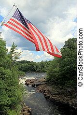 American flag over water - Emotive scene of rushing water...