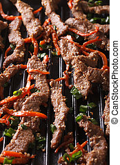 Korean cuisine: bulgogi of grilled macro Vertical - Korean...