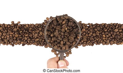 Magnifying glass increases the coffee beans, motion up