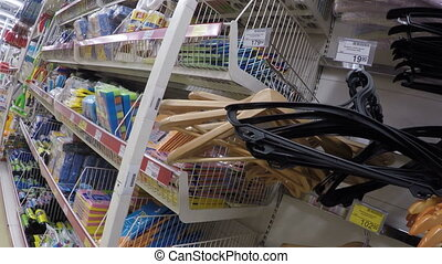 selects a hanger in the store in the first person on the...