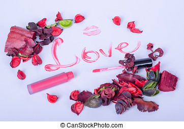 Pink flowers and lipstick kiss on a white background - Pink...
