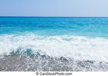 cote dAzur, France - stone beach and turquiose water splash...