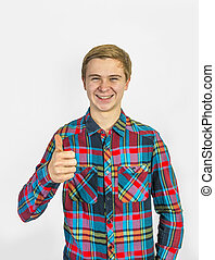 boy showing thumbs up sign