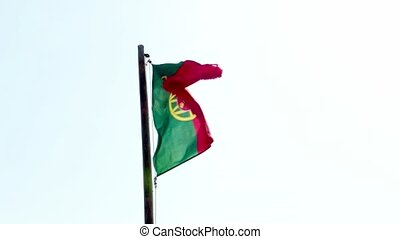 Portugal Flag waving in the wind against a clear sky.