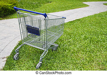 Empty shopping cart - An empty shopping cart at a public...