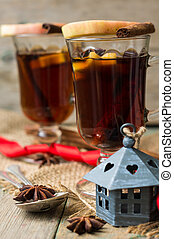 Mulled tea with spices on the old rustic background