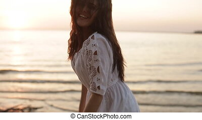 beauty happy smiling woman at sea at sunset slow motion -...