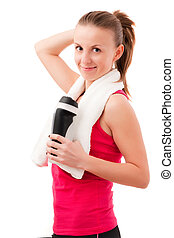 Young woman after fitness with towel