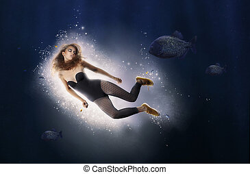 Creativity Fantasy Woman is Diving in Water