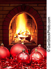 red Xmas baubles and tinsel with home fireplace - red Xmas...