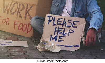 Homeless beggar asking for help, adult man begging on the...