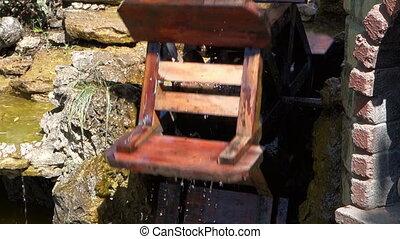 draws water watermill wheel