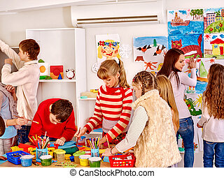 Child painting at art school. - Group children painting at...