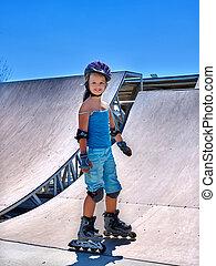 Girl riding on roller skates in skatepark - Little girl...