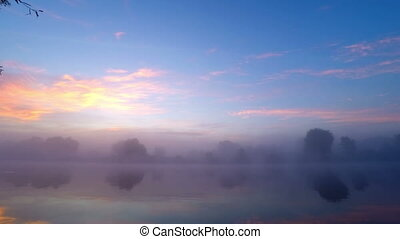 Sunrise  in  Fog on River Water.