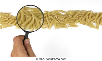 Hand with magnifying glass over the pasta, moves along