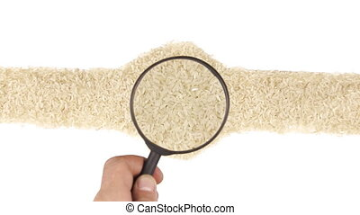 Magnifying glass increases the rice grains, motion up