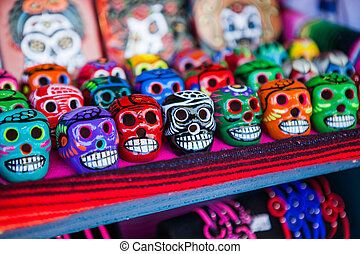 Colorful skulls souvenirs in Mexico on the market. -...