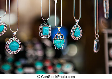 Hand made oval pendants with turquoise stone in a silver...