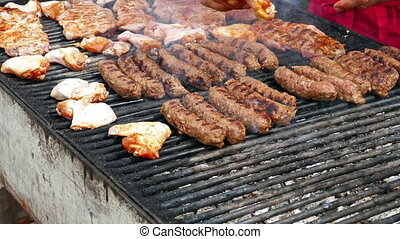 Romanian sausages (mici) chicken wings and pork, cooked...