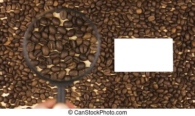 Magnifying glass increases the coffee beans and  business card with space for your text