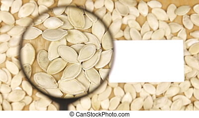 Magnifying glass increases the pumpkin seeds and business...