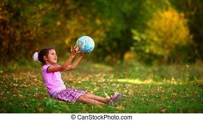 girl  teen sitting green grass playing studying Globe happy
