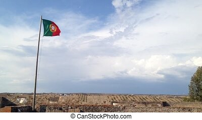 Flag of Portugal waving on top of Castro Marim Castle in...