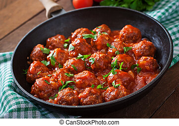 Meatballs in sauce. - Meatballs in sweet and sour tomato...