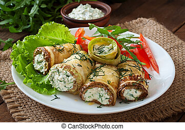 Zucchini rolls with cheese and dill.