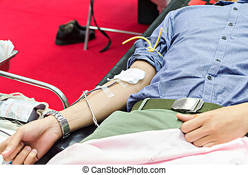 Blood Donors Making Donation In Hospital, focus at center