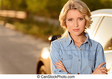 Attractive girl standing near car - Charming glance Pleasant...