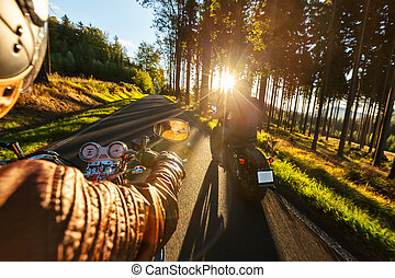 Biker riding motorcycle in sunny morning - Biker riding...