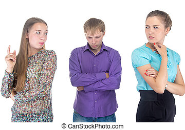 Puzzled young man and two blond women - Puzzled young man...